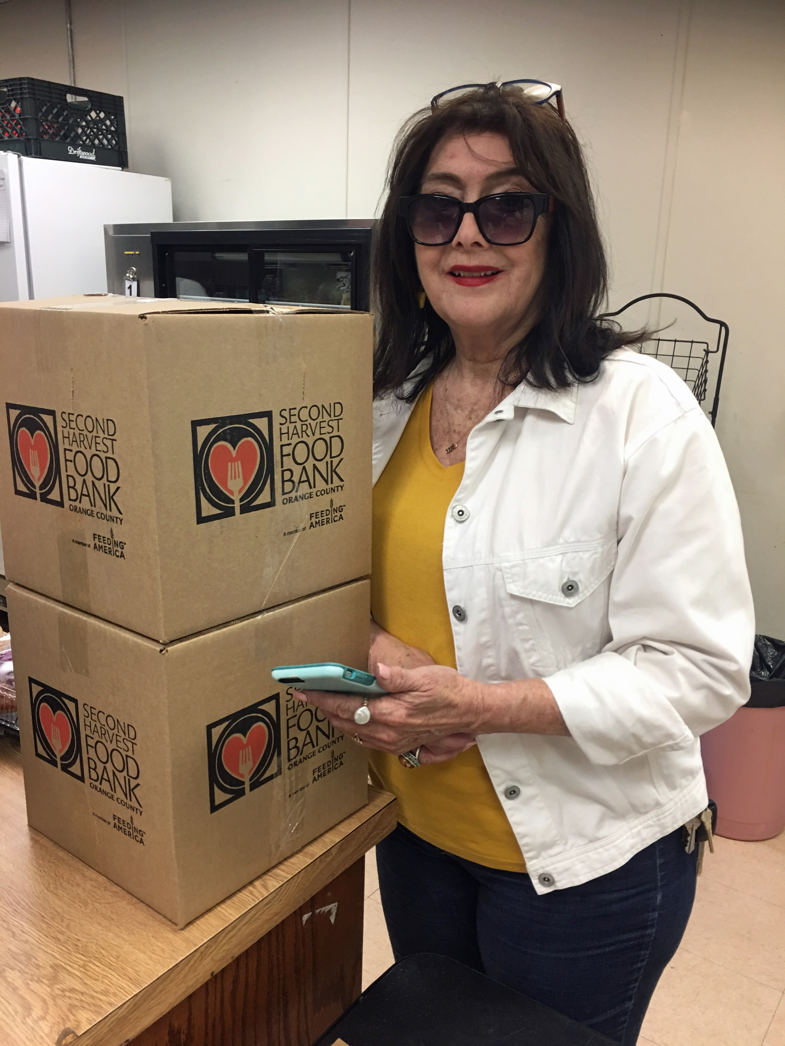 Rose lifts donated food boxes
